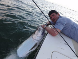 Happy client with his trophy Tarpon